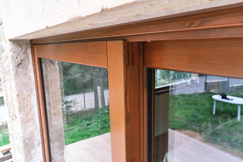 finestres de fusta amb gran transmitància tèrmica i aïllament acústic a Girona fabricades per Carreté Finestres -silva 68 finestra perfil europeu